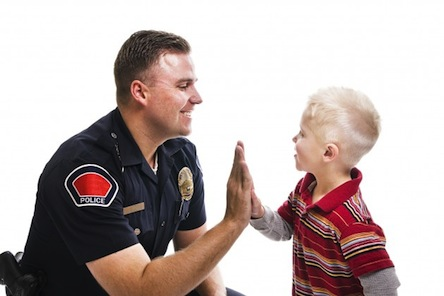 Police-high-five-with-child-Credit-iStockphoto-630x420