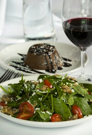 Spinach Salad with candied walnuts and goat cheese and Chocolate Lava cake are among the offerings in the living room theaters at Cinetopia.  Photo by Steven Lane