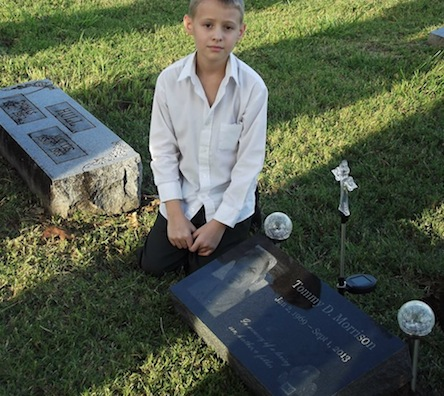 Morrison's son Tristin Duke at his father's graveside