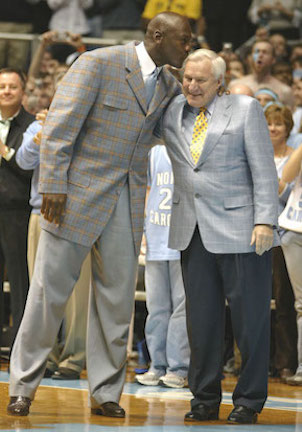 Michael Jordan plants one on former NorthCarolina coach Dean Smith of Kansas