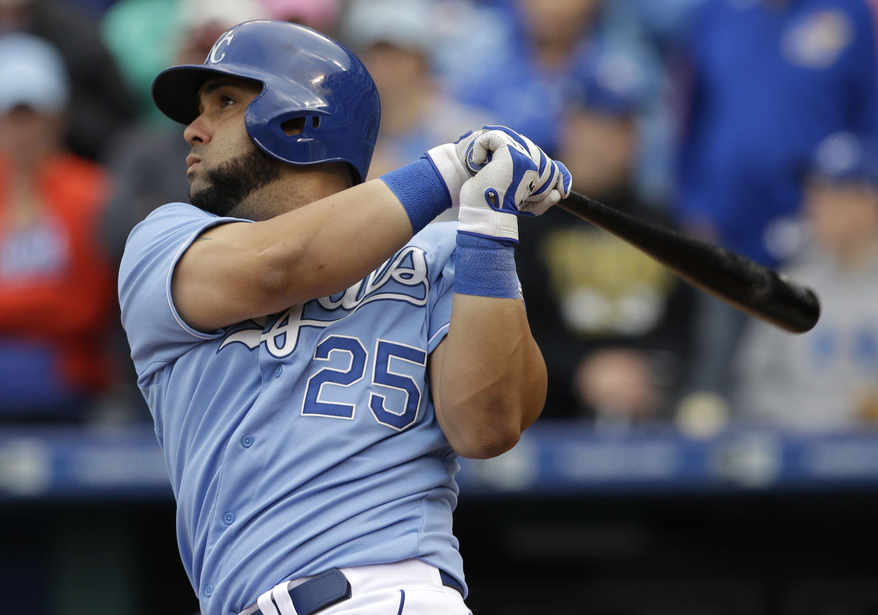 Kansas City Royals designated hitter Kendrys Morales (25) hits a two-run double during the eighth inning of a baseball game against the Oakland Athletics at Kauffman Stadium in Kansas City, Mo., Sunday, April 19, 2015. The Royals defeated the Athletics 4-2. (AP Photo/Orlin Wagner)