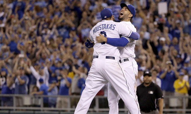 Kansas City Royals' Eric Hosmer, right, and Mike Moustakas celebrate after the Royals' baseball game against the Seattle Mariners on Thursday, Sept. 24, 2015, in Kansas City, Mo. The Royals won 10-4 and clinched the AL Central. (AP Photo/Charlie Riedel)